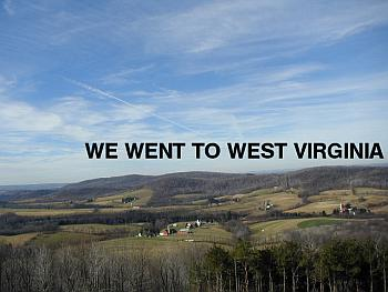 "A picture of a valley with farmhouses with the words ""We went to West Virginia"" hanging in the sky."